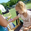 Jean Sprague, 4, of Fitchburg, gets an airbrush tattoo at the Bolton Fair on Saturday morning. SENTINEL & ENTERPRISE / Ashley Green