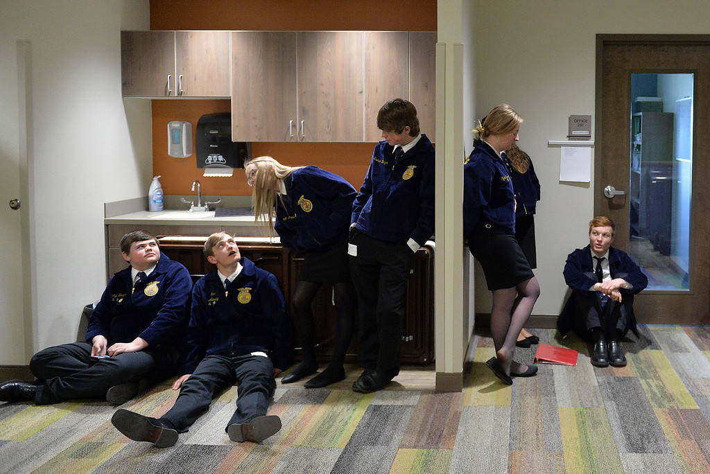 Justin Sheely | The Sheridan Press<br /> FFA students visit during the Border Wars ag competition at the Mars Agriculture Center at Sheridan College Wednesday, March 28, 2018.