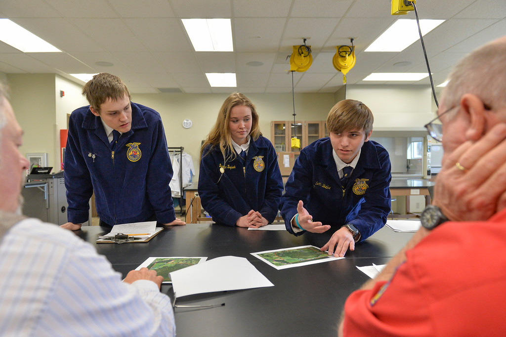 Justin Sheely | The Sheridan Press<br /> Kaycee students, from left, Ryan Walker, Kamryn Kozisek and Seth Bubke deliver their presentation to judges during the Border Wars ag competition at the Mars Agriculture Center at Sheridan College Wednesday, March 28, 2018.