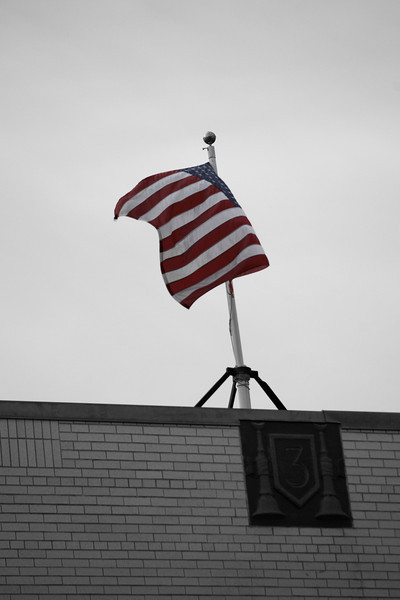 23 Mar 2014 Boston, MA-The American Flag waves in a mild wind  atop Boston Fire Department's Engine Company 3, located at 618 Harrison Avenue in the South End.