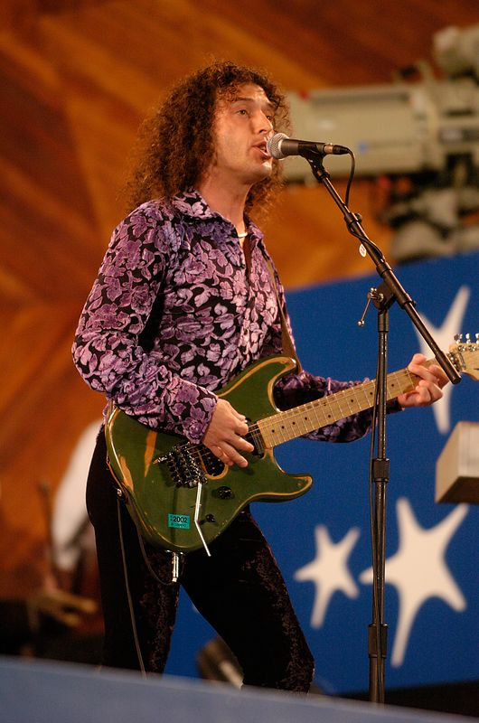 A guitarist for David Lee Roth plays during a rehearsal performance for Boston's Fourth of July celebration at the Hatch Shell in Boston, Saturday, July 3, 2004.