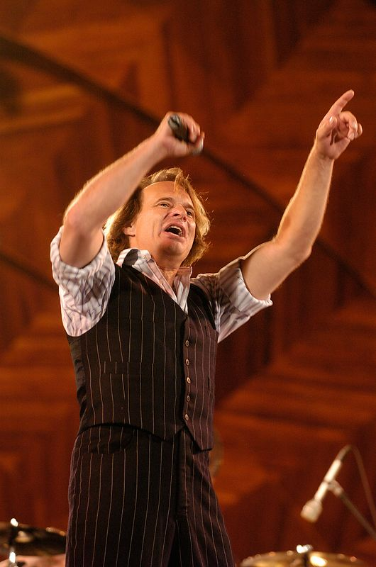 Former Van Halen frontman David Lee Roth sings during a rehearsal performance for Boston's Fourth of July celebration at the Hatch Shell in Boston, Saturday, July 3, 2004.