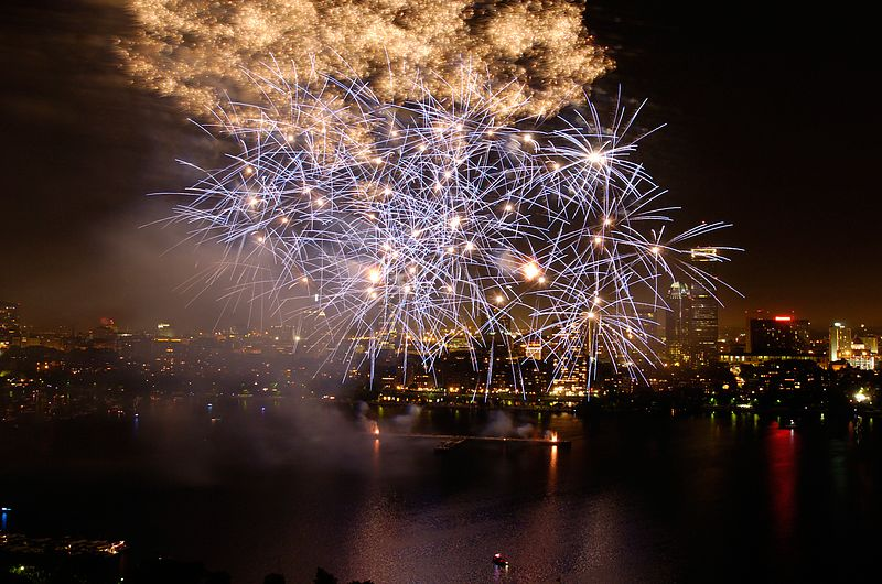 Fireworks explode over the Charles River during Boston's Fourth of July celebration, as seen from the MIT Green Building in Cambridge, Sunday, July 4, 2004.