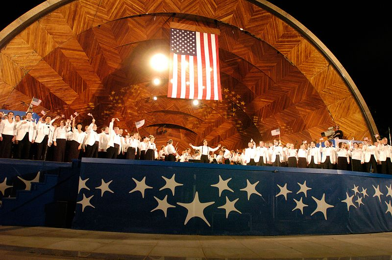 The Boston Pops concludes the rehearsal performance with flag-waving and a crowd sing-along.