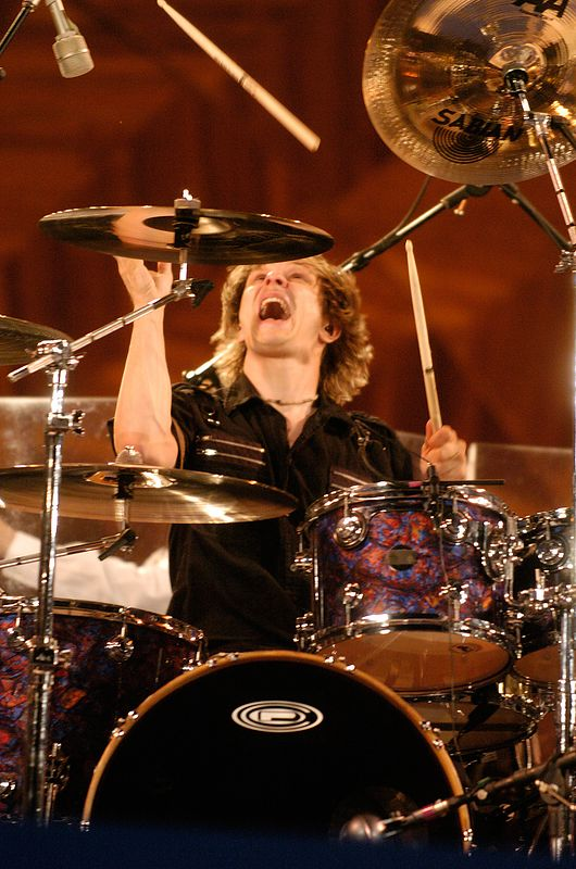 A drummer for David Lee Roth flips his stick in the air during a rehearsal performance for Boston's Fourth of July celebration at the Hatch Shell in Boston, Saturday, July 3, 2004.