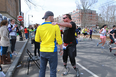 Bradley Rhoton supporting Scott Rigsby during Boston Marathon on April 15, 2013 at mile marker 22. Photo by Lindsey Atterton.