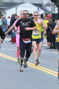 Scott Rigsby running in the Boston Marathon on April 15, 2013. Photo taken at mile marker 10 in Natick, MA.