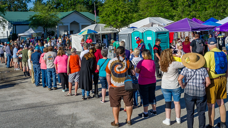 The line for the Bostwick Blueberry Festival pancakes stretches out into the vendor area from the Bostwick Community Building on Saturday morning. Fran Ruchalski/Palatka Daily News