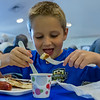 Six-year-old Zachary Rutski chows down on blueberry pancakes at the Bostwick Blueberry Festival on Saturday morning. Fran Ruchalski/Palatka Daily News