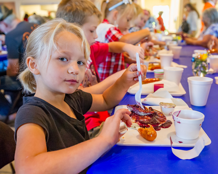 Taylor Moses, 6, , is not too happy she's disturbed as she gets her fill of Bostwick Blueberry Festival pancakes. Fran Ruchalski/Palatka Daily News