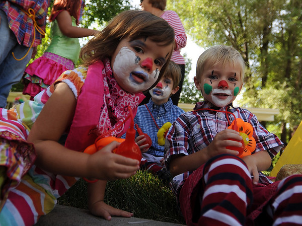 "Elsa Vossler, left, Ben Harding and Sam Harding are rodeo clowns for the Jax parade float.<br /> The Boulder County Fair Parade was held in downtown Longmont on Saturday.<br /> For more photos  and a video of the parade, go to  <a href=""http://www.dailycamera.com"">http://www.dailycamera.com</a><br />  Cliff Grassmick / July 31, 2010"
