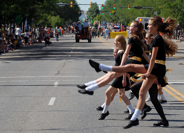"""Members of the Martin Percival School of Irish Dance perform during the fair parade.<br /> The Boulder County Fair Parade was held in downtown Longmont on Saturday.<br /> For more photos  and a video of the parade, go to  <a href=""""http://www.dailycamera.com"""">http://www.dailycamera.com</a><br />  Cliff Grassmick / July 31, 2010"""
