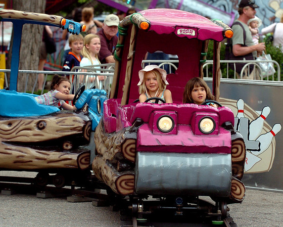 """Jaeda Hastings, left, and Selma-Jane Yavuz, ride the train at the creek festival on Saturday.<br /> The Boulder Creek Festival will continue on Sunday and Monday along the creek and Central Park.<br /> For more photos and a video, go to  <a href=""""http://www.dailycamera.com"""">http://www.dailycamera.com</a><br /> Cliff Grassmick / May 29, 2010"""