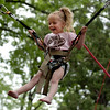 "Anya Hoepfinger, 6, tries out the bungi bouncer on Saturday.<br /> The Boulder Creek Festival will continue on Sunday and Monday along the creek and Central Park.<br /> For more photos and a video, go to  <a href=""http://www.dailycamera.com"">http://www.dailycamera.com</a><br /> Cliff Grassmick / May 29, 2010"