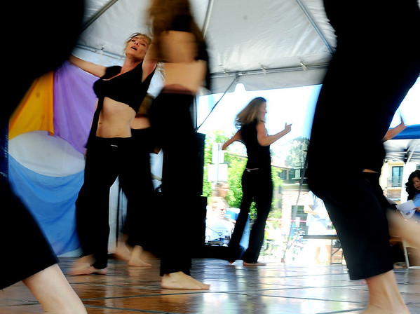 Kendra Howard, left, dances with her group, Planet Motion, during the Boulder Creek Festival on Sunday.<br /> The Boulder Creek Festival continues on Memorial Day.<br /> Cliff Grassmick / May 30, 2010