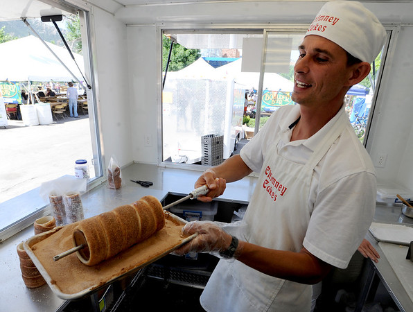 "Szabi Bujdoso, owner of Chimney Cakes of Denver,  made some yummy cakes at  the Boulder Creek Festival on Sunday.<br /> For a video and more photos of the Creek Festival on May 26th, go to  <a href=""http://www.dailycamera.com"">http://www.dailycamera.com</a>.<br /> Cliff Grassmick / May 27, 2012"