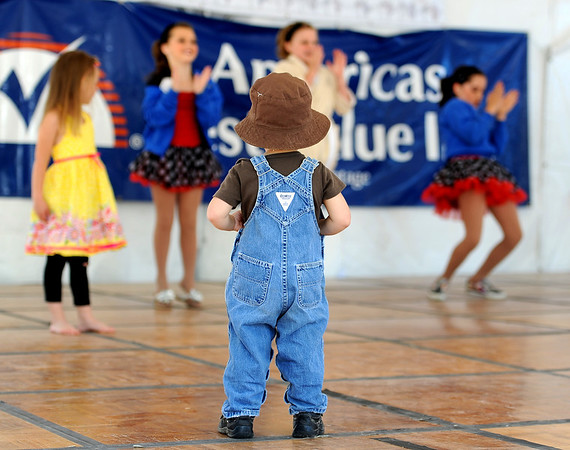 "Rua Grana, 22-months, gets on stage to get a closer look at the open dance at the Boulder Creek Festival on Sunday.<br /> For a video and more photos of the Creek Festival on May 26th, go to  <a href=""http://www.dailycamera.com"">http://www.dailycamera.com</a>.<br /> Cliff Grassmick / May 27, 2012"