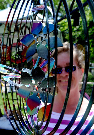"Lynn Edelman looks through a creation from All in the Wind Art at the Boulder Creek Festival on Sunday.<br /> For a video and more photos of the Creek Festival on May 26th, go to  <a href=""http://www.dailycamera.com"">http://www.dailycamera.com</a>.<br /> Cliff Grassmick / May 27, 2012"