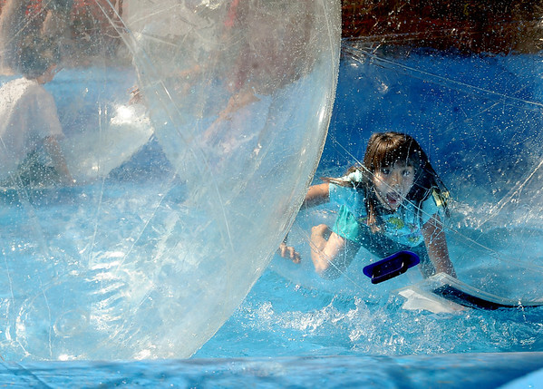 """Kira Cassulo, 8, is  almost able to walk on water in a bubble at the Boulder Creek Festival on Sunday.<br /> For a video and more photos of the Creek Festival on May 26th, go to  <a href=""""http://www.dailycamera.com"""">http://www.dailycamera.com</a>.<br /> Cliff Grassmick / May 27, 2012"""