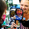 "Mia Teicher, 4, imitates a cat by roaring as face painter Amber Jarvis holds up the mirror at the Boulder Creek Hometown Fair in Boulder Saturday, Sept. 5, 2009. Along with the weekly farmer's market, the fair hosted fair games, face painting, and live music.<br /> DAILY CAMERA/Kasia Broussalian<br /> For more photos and a video of the event, please visit  <a href=""http://www.dailycamera.com"">http://www.dailycamera.com</a>"