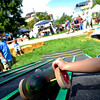 "Oliver Merkner, 3, of Denver, rolls down his decorated zucchini before the start of the Great Zucchini Race at the Boulder Creek Hometown Fair in Boulder Saturday, Sept. 5, 2009. Along with the weekly farmer's market, the fair hosted fair games, face painting, and live music.<br /> DAILY CAMERA/Kasia Broussalian<br /> For more photos and a video of the event, please visit  <a href=""http://www.dailycamera.com"">http://www.dailycamera.com</a>"