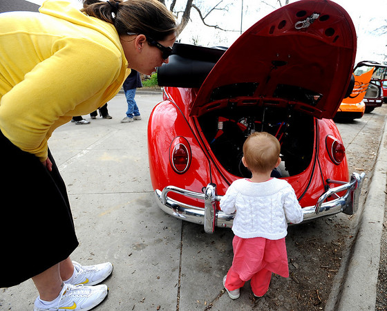 "Olivia Stewart, 19-months, checks out the electric parts in this 1961 Volkswagon beetle with her mother Kirstin Johnson.<br /> Earthfest Boulder, a celebration of sustainability and community, was held at Central Park Sunday.<br /> For more photos and a video of the festivities, go to  <a href=""http://www.dailycamera.com"">http://www.dailycamera.com</a>.<br /> Cliff Grassmick / April 25, 2010"