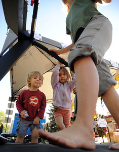 Liam Harrison, 3,  and his sister Lucy, 5, watch their mother Dana Runge, use a Pacemaster at the Functional Fitness booth. Boulder Green Streets, a celebration of sustainability and public health, was held on Pearl Street  on Sunday. For more photos of Green Streets, go to www.dailycamera.com. Cliff Grassmick / September 19, 2010