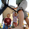 "Liam Harrison, 3,  and his sister Lucy, 5, watch their mother Dana Runge, use a Pacemaster at the Functional Fitness booth.<br /> Boulder Green Streets, a celebration of sustainability and public health, was held on Pearl Street  on Sunday.<br /> For more photos of Green Streets, go to  <a href=""http://www.dailycamera.com"">http://www.dailycamera.com</a>.<br /> Cliff Grassmick / September 19, 2010"