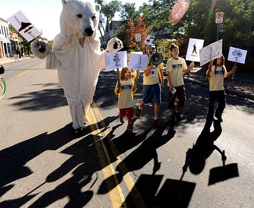Members of Earth Guardians, a group that teaches environmental education, activism and leadership, held a march for a green planet Earth down Pearl Street. Boulder Green Streets, a celebration of sustainability and public health, was held on Pearl Street  on Sunday. For more photos of Green Streets, go to www.dailycamera.com. Cliff Grassmick / September 19, 2010