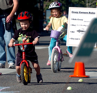 Owen Stanzel, left, and his sister, Ellie, take on one of the bike courses on Pearl Street. Boulder Green Streets, a celebration of sustainability and public health, was held on Pearl Street  on Sunday. For more photos of Green Streets, go to www.dailycamera.com. Cliff Grassmick / September 19, 2010
