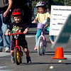"Owen Stanzel, left, and his sister, Ellie, take on one of the bike courses on Pearl Street.<br /> Boulder Green Streets, a celebration of sustainability and public health, was held on Pearl Street  on Sunday.<br /> For more photos of Green Streets, go to  <a href=""http://www.dailycamera.com"">http://www.dailycamera.com</a>.<br /> Cliff Grassmick / September 19, 2010"