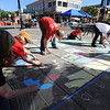 "Cathy O'Steen, left, Pat Monroe, Julie Mahoney, Jasmine Sanchez, Bob Mahoney and Laurie Grassman, make a mural from chalk at the celebration.<br /> Boulder Green Streets, a celebration of sustainability and public health, was held on Pearl Street  on Sunday.<br /> For more photos of Green Streets, go to  <a href=""http://www.dailycamera.com"">http://www.dailycamera.com</a>.<br /> Cliff Grassmick / September 19, 2010"