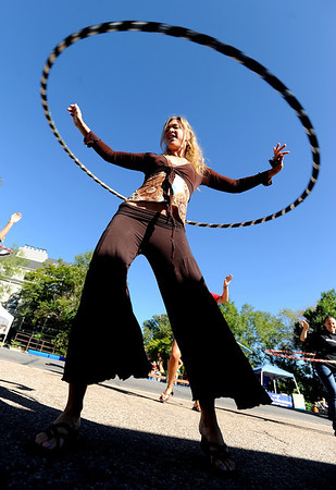 """Kristina Sutcliffe, of O Dance, held a hoop dance class during the celebration.<br /> Boulder Green Streets, a celebration of sustainability and public health, was held on Pearl Street  on Sunday.<br /> For more photos of Green Streets, go to  <a href=""""http://www.dailycamera.com"""">http://www.dailycamera.com</a>.<br /> Cliff Grassmick / September 19, 2010"""