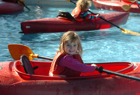 "Mallory Austin, 3, of Louisville, tries out the kayaks from Avid4Adventure.<br /> Boulder Green Streets, a celebration of sustainability and public health, was held on Pearl Street  on Sunday.<br /> For more photos of Green Streets, go to  <a href=""http://www.dailycamera.com"">http://www.dailycamera.com</a>.<br /> Cliff Grassmick / September 19, 2010"