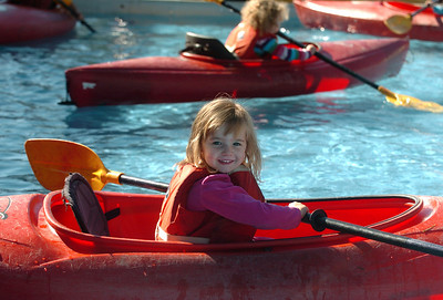 Mallory Austin, 3, of Louisville, tries out the kayaks from Avid4Adventure. Boulder Green Streets, a celebration of sustainability and public health, was held on Pearl Street  on Sunday. For more photos of Green Streets, go to www.dailycamera.com. Cliff Grassmick / September 19, 2010