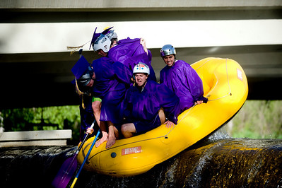 Spencer Lacy, 18, Gordon Bowman, 18, Jake More, 18, Alex Gomez-Andrews, 18, Leo Skovron, 17, and Stephen Scowcroft, 17, use their weight to push themselves over the dam at Broadway on the Boulder Creek as they raft to their graduation ceremony at Boulder High School, Saturday, May 22, 2010.   Kasia Broussalian  For a video of the graduation ceremony, please visit www.dailycamera.com