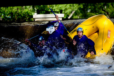 Spencer Lacy, 18, Gordon Bowman, 18, Jake More, 18, Alex Gomez-Andrews, 18, Leo Skovron, 17, and Stephen Scowcroft, 17, fall over the dam at Broadway on the Boulder Creek as they raft to their graduation ceremony at Boulder High School, Saturday, May 22, 2010.   Kasia Broussalian  For a video of the graduation ceremony, please visit www.dailycamera.com