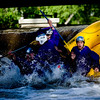 "Spencer Lacy, 18, Gordon Bowman, 18, Jake More, 18, Alex Gomez-Andrews, 18, Leo Skovron, 17, and Stephen Scowcroft, 17, fall over the dam at Broadway on the Boulder Creek as they raft to their graduation ceremony at Boulder High School, Saturday, May 22, 2010. <br /> <br /> Kasia Broussalian<br /> <br /> For a video of the graduation ceremony, please visit  <a href=""http://www.dailycamera.com"">http://www.dailycamera.com</a>"