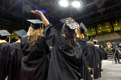 Shua Hna Lor waves to friends and family during the Monarch High School Commencement at the Coors Events Center on the CU Boulder Campus on Saturday May 22, 2010. For more photos and a video of the graduation go to www.dailycamera.com Photo by Paul Aiken / The Camara /