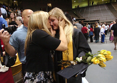 Kaley Feenstra, with tears in her eyes, gets a hug from her mother Rhonda after the Monarch High School Commencement at the Coors Events Center on the CU Boulder Campus on Saturday May 22, 2010. For more photos and a video of the graduation go to www.dailycamera.com Photo by Paul Aiken / The Camara /