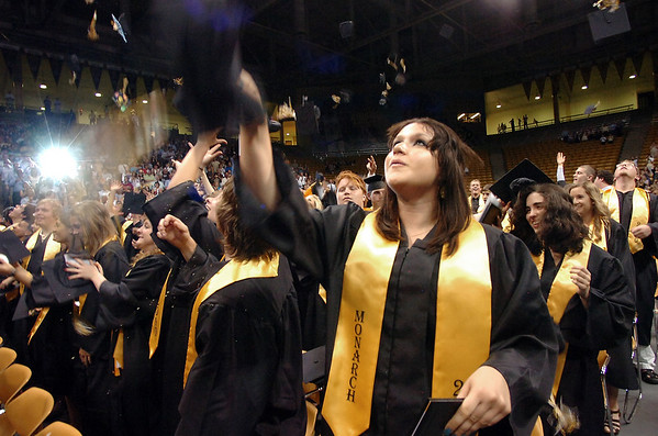 "Katelyn Engel tosses her cap into the air during the Monarch High School Commencement at the Coors Events Center on the CU Boulder Campus on Saturday May 22, 2010.<br /> For more photos and a video of the graduation go to  <a href=""http://www.dailycamera.com"">http://www.dailycamera.com</a><br /> Photo by Paul Aiken / The Camara /"