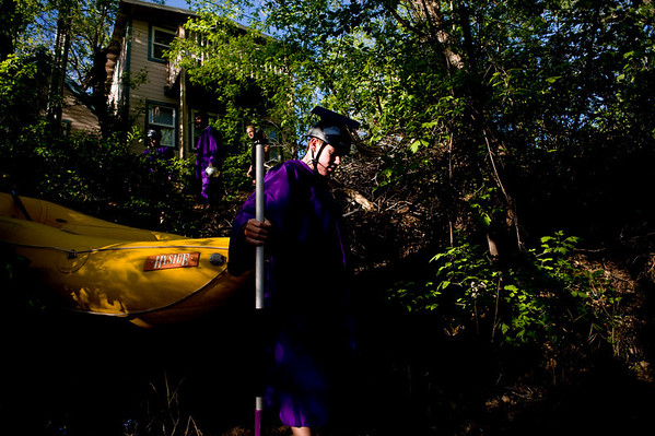 "Spencer Lacy, 18, carries the raft down to the Boulder Creek to raft to his graduation ceremony at Boulder High School, Saturday, May 22, 2010. <br /> <br /> Kasia Broussalian<br /> <br /> For a video of the graduation ceremony, please visit  <a href=""http://www.dailycamera.com"">http://www.dailycamera.com</a>"
