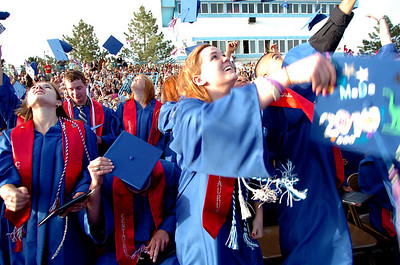 From left to right Hannah McCallum, Steve McCleskey, Madeline McCormack, and Mauricio Medellin toss their caps into the air during  the Centaurus High School Commencement at the school in Lafayette on Saturday May 22, 2010. For more photos and a video of the graduation go to www.dailycamera.com Photo by Paul Aiken / The Camara /
