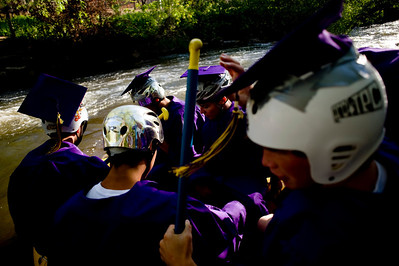 Spencer Lacy, 18, Gordon Bowman, 18, Jake More, 18, Alex Gomez-Andrews, 18, Leo Skovron, 17, and Stephen Scowcroft, 17, prepare to raft down the Boulder Creek to their graduation ceremony at Boulder High School, Saturday, May 22, 2010.   Kasia Broussalian  For a video of the graduation ceremony, please visit www.dailycamera.com