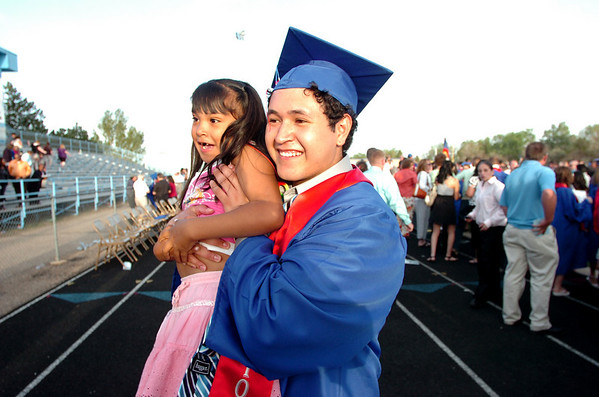 "Emmanuel Estevane holds up his cousin America Salcido during family photo time after the Centaurus High School Commencement at the school in Lafayette on Saturday May 22, 2010.<br /> For more photos and a video of the graduation go to  <a href=""http://www.dailycamera.com"">http://www.dailycamera.com</a><br /> Photo by Paul Aiken / The Camara /"