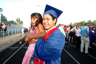 Emmanuel Estevane holds up his cousin America Salcido during family photo time after the Centaurus High School Commencement at the school in Lafayette on Saturday May 22, 2010. For more photos and a video of the graduation go to www.dailycamera.com Photo by Paul Aiken / The Camara /