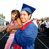 """Emmanuel Estevane holds up his cousin America Salcido during family photo time after the Centaurus High School Commencement at the school in Lafayette on Saturday May 22, 2010.<br /> For more photos and a video of the graduation go to  <a href=""""http://www.dailycamera.com"""">http://www.dailycamera.com</a><br /> Photo by Paul Aiken / The Camara /"""