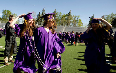 "(From left to right) Maggie Kopel, 18, Melanie Robertz, 18, and Leah Regan-Smith, 18, walk in to Pomp and Circumstance"" during the commencement ceremony at Boulder High School, Saturday, May 22, 2010.   Kasia Broussalian  For a video of the graduation ceremony, please visit www.dailycamera.com"
