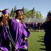 "(From left to right) Maggie Kopel, 18, Melanie Robertz, 18, and Leah Regan-Smith, 18, walk in to Pomp and Circumstance"" during the commencement ceremony at Boulder High School, Saturday, May 22, 2010. <br /> <br /> Kasia Broussalian<br /> <br /> For a video of the graduation ceremony, please visit  <a href=""http://www.dailycamera.com"">http://www.dailycamera.com</a>"