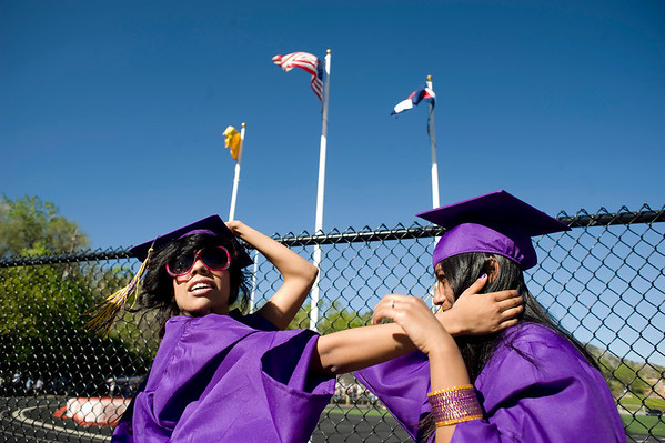 "Liliana Segura, 17, (left) and Bhabina Shrestha, 18, hold on to each others' hats during the commencement ceremony at Boulder High School, Saturday, May 22, 2010. <br /> <br /> Kasia Broussalian<br /> <br /> For a video of the graduation ceremony, please visit  <a href=""http://www.dailycamera.com"">http://www.dailycamera.com</a>"